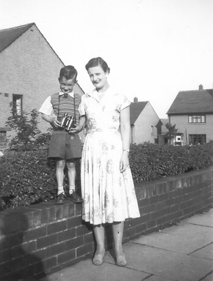 Lady with boy stood on wall