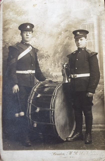 two young men in uniform
